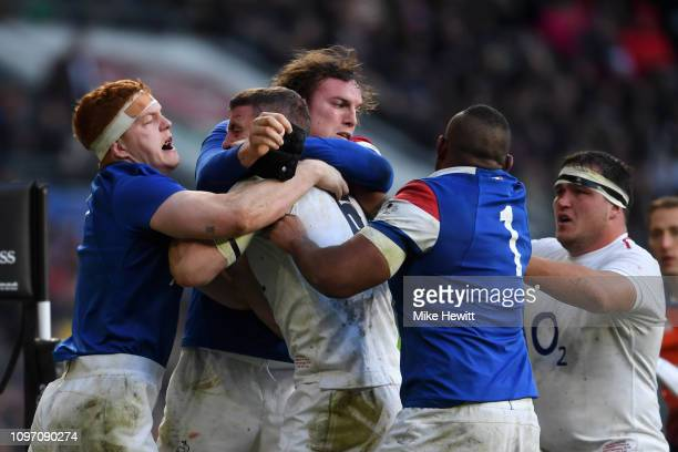 Mark Wilson of England clashes with Felix Lambey of France during the Guinness Six Nations match between England and France at Twickenham Stadium on...
