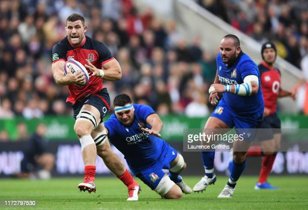Mark Wilson of England evades David Sisi of Italy during the 2019 Quilter International match between England and Italy at St James' Park on...