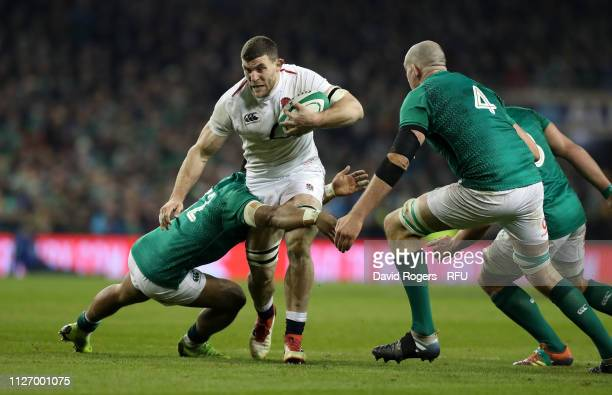 DUBLIN IRELAND FEBRUARY 02 Mark Wilson of England is tackled by Bundee Aki during the Guinness Six Nations match between Ireland and England at Aviva...
