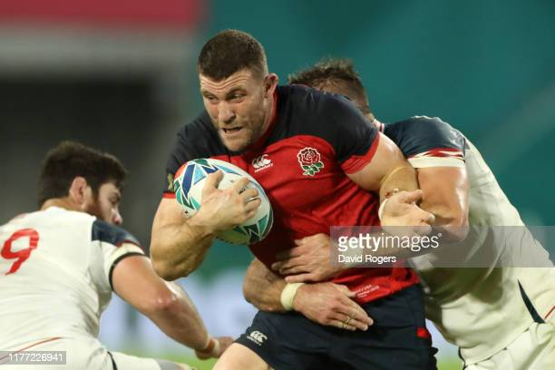 Mark Wilson of England is tackled by Cam Dolan of USA during the Rugby World Cup 2019 Group C game between England and USA at Kobe Misaki Stadium on...