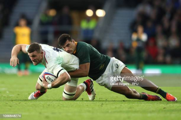 Mark Wilson of England is tackled by Damian de Allende of South Africa during the Quilter International match between England and South Africa at...