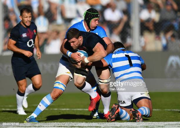 Mark Wilson of England is tackled by Matias Alemanno and Lucas Noguera of Argentina during the International Test match between Argentina and England...