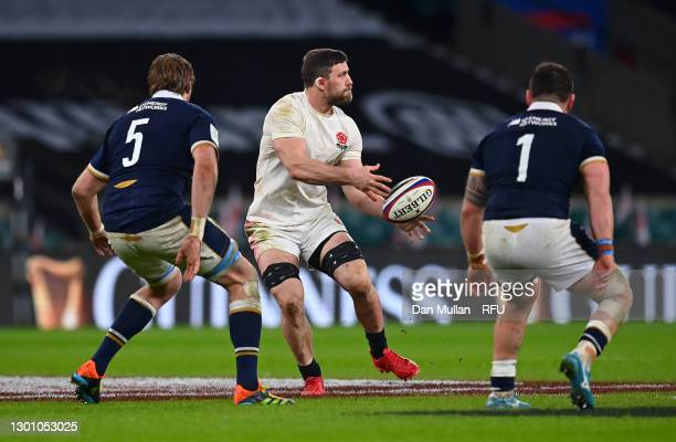Mark Wilson of England offloads under pressure from Jonny Gray of Scotland during the Guinness Six Nations match between England and Scotland at...