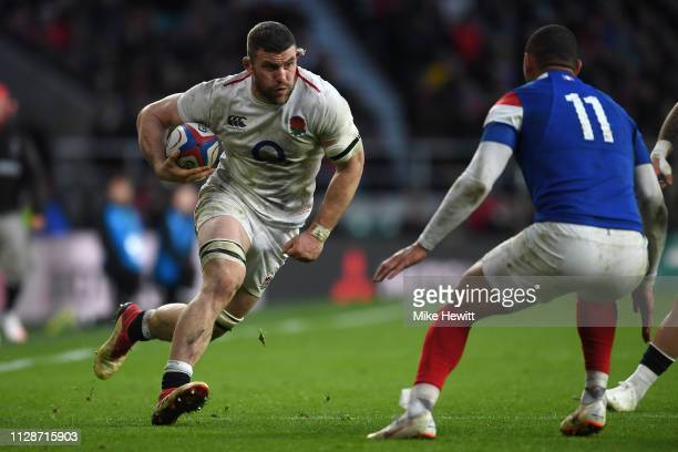 Mark Wilson of England runs at Gael Fickou of France during the Guinness Six Nations match between England and France at Twickenham Stadium on...
