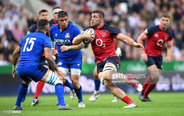 Mark Wilson of England runs at Jayden Hayward of Italy during the 2019 Quilter International match between England and Italy at St James' Park on...