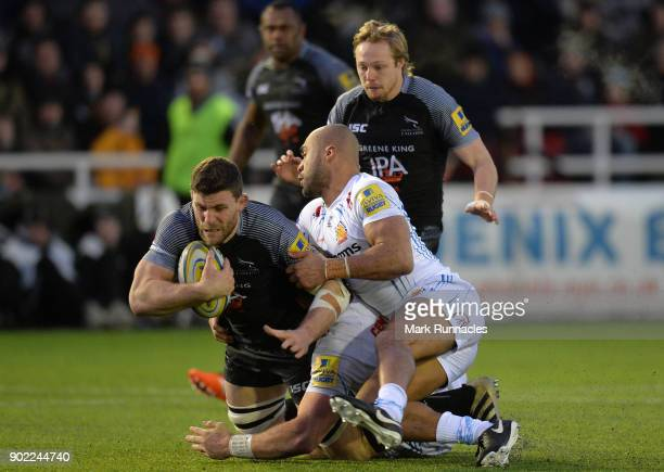 Mark Wilson of Newcastle Falcons is tackled by Olly Woodburn of Exeter Chiefs during the Aviva Premiership match between Newcastle Falcons and Exeter...