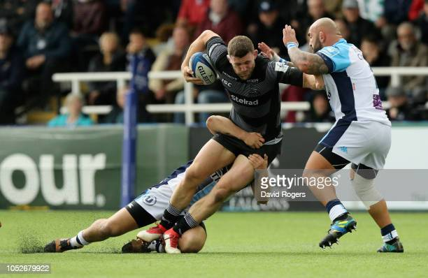 Mark Wilson of Newcastle Falcons is tackled during the Champions Cup match between Newcastle Falcons and Montpellier Herault Rugby at Kingston Park...