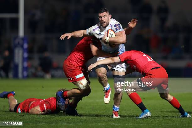 Mark Wilson of Sale Sharks is tackled by Ali Crossdale and Callum Hunter-Hill of Saracens during the Premiership Rugby Cup Semi-Final match between...