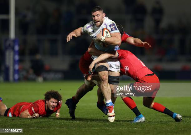 Mark Wilson of Sale Sharks is tackled by Ali Crossdale and Callum HunterHill of Saracens during the Premiership Rugby Cup SemiFinal match between...
