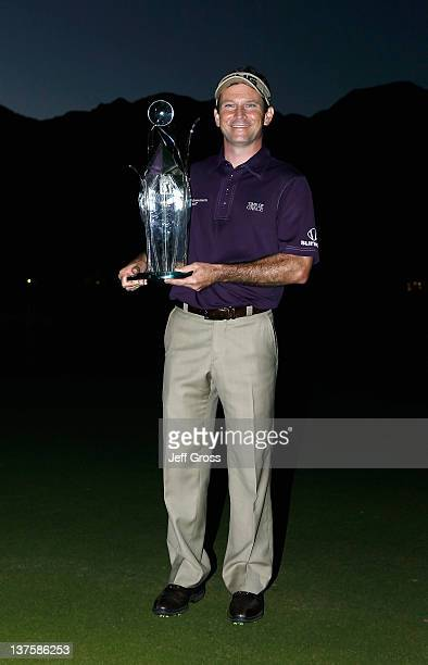 Mark Wilson poses with the trophy after winning the Humana Challenge In Partnership With The Clinton Foundation at the Palmer Private Course at PGA...