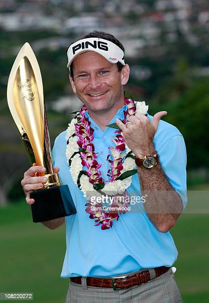 Mark Wilson poses with the trophy after winning the Sony Open at Waialae Country Club on January 16 2011 in Honolulu Hawaii