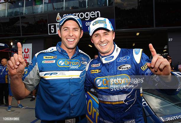 Mark Winterbottom driver of the Orrcon Steel FPR Falcon celebrates with teammate Luke Youlden after taking pole position in the Top 10 shootout for...