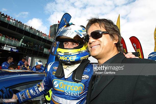 Mark Winterbottom driver of the Orrcon Steel FPR Falcon is seen on the grid with singer Jon Stevens prior to the Bathurst 1000 which is round 10 of...