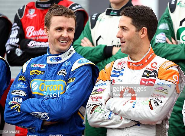 Mark Winterbottom driver of the Orrcon Steel FPR Falcon talks with Jamie Whincup driver of the Team Vodafone Holden on the grid with singer Jon...
