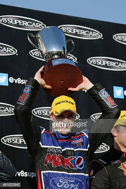 Mark Winterbottom driver of the Pepsi max Crew Ford celebrates on the podium after winning race 19 for the Triple Crown Darwin which is round six of...