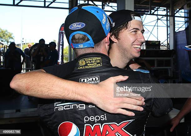 Mark Winterbottom driver of the Pepsi Max Crew Ford celebrates with Chaz Mostert after claiming pole position for race 34 during qualifying for the...