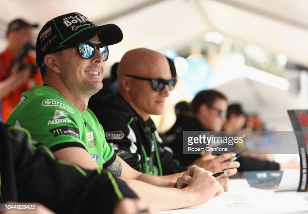 Mark Winterbottom driver of the The BottleO Racing Team Ford Falcon FGX is seen during an autograph session during previews ahead of the Bathurst...