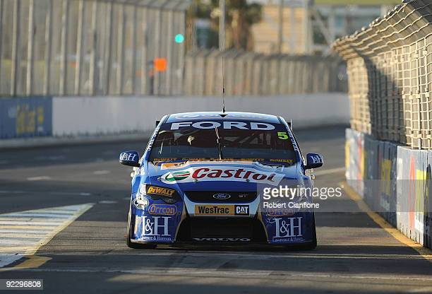 Mark Winterbottom drives the Ford Performance Racing Ford into pitlane during qualifying for round 11 of the V8 Supercar Championship Series at the...