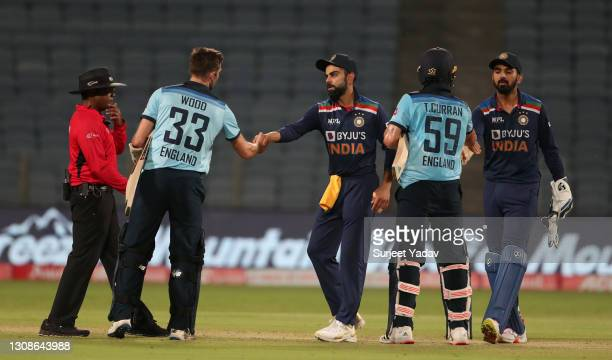 Mark Wood and Adil Rashid of England shake hands with India captain Virat Kohli and Kl Rahul after losing 1st One Day International between India and...