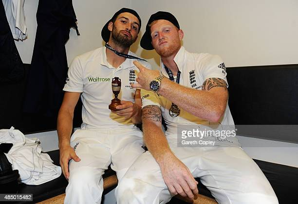 Mark Wood and Ben Stokes of England celebrate with the ashes urn in the dressing rooms after the 5th Investec Ashes Test match between England and...