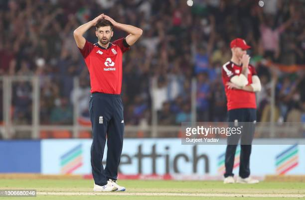 Mark Wood and Ben Stokes of England cut dejected figures after a boundary during the 1st T20 International match between India and England at Sardar...