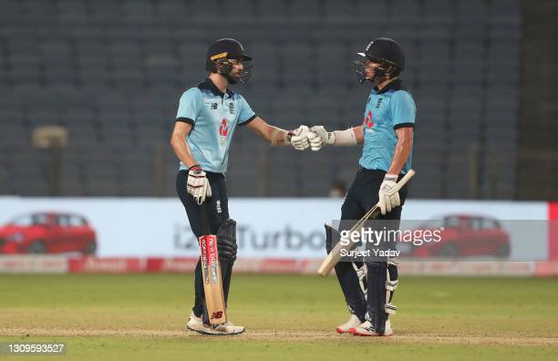 Mark Wood and Sam Curran of England interact during the 3rd One Day International match between India and England at MCA Stadium on March 28, 2021 in...