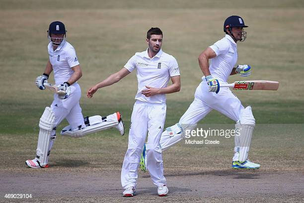 Mark Wood bowling for St Kitts is flanked by Adam Lyth and Alastair Cook of England during day two of the 2nd Invitational Warm Up match between St...