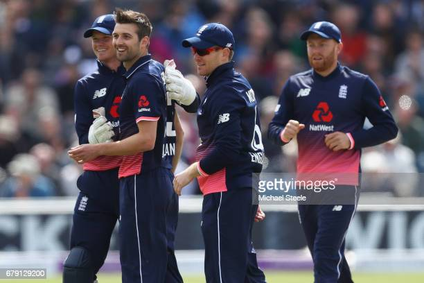 Mark Wood celebrates with Sam Billings and Eoin Morgan after taking the wicket of Paul Stirling of Ireland during the Royal London One Day...