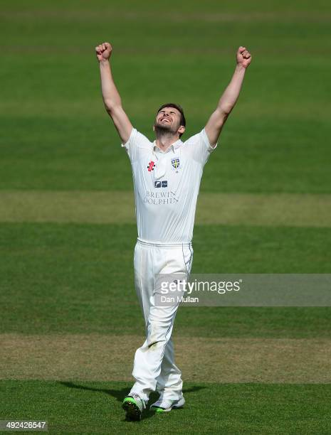 Mark Wood of Durham celebrates after taking the wicket of Jamie Overton of Somerset his fifth of the match during day two of the LV County...