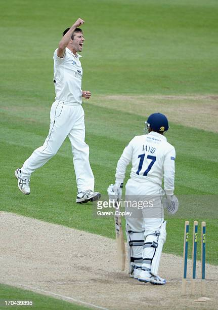 JUNE 13 Mark Wood of Durham celebrates dismissing Ateeq Javid of Warwickshire during day two of the LV County Championship Division One match between...