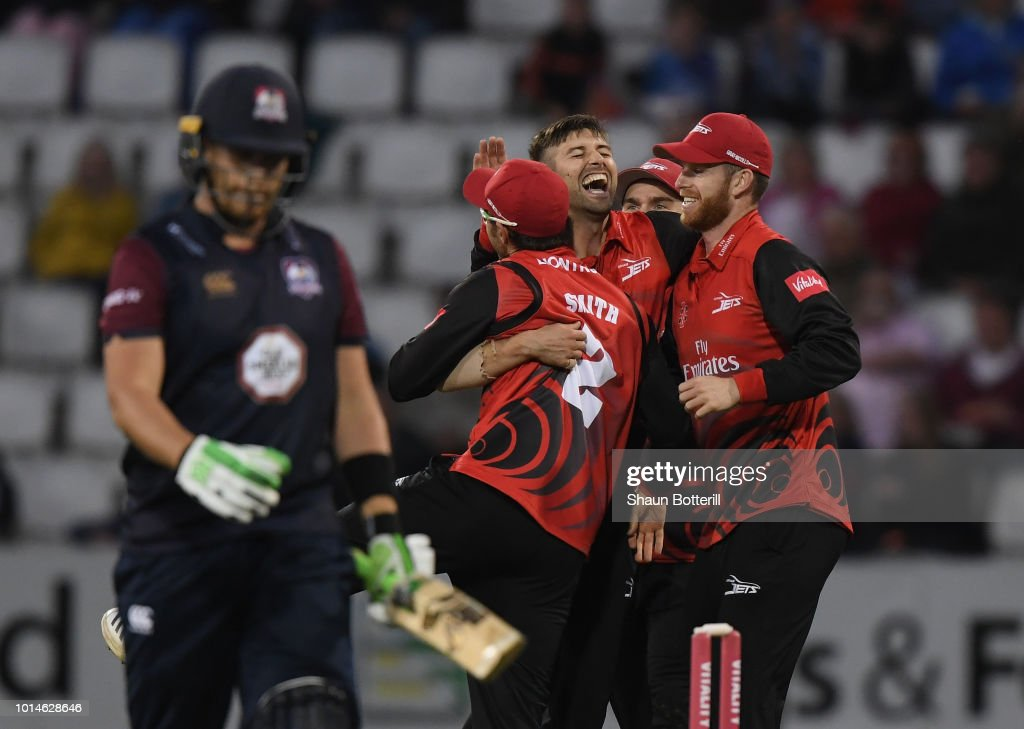 Mark Wood of Durham Jets is congratulated by team mates after taking a wicket during the Vitality Blast match between Northamptonshire Steelbacks and Durham Jets at The County Ground on August 10, 2018 in Northampton, England.