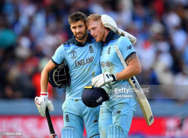 Mark Wood of England and Ben Stokes of England walk off at the end of the innings and before the commencement of the super over during the Final of...