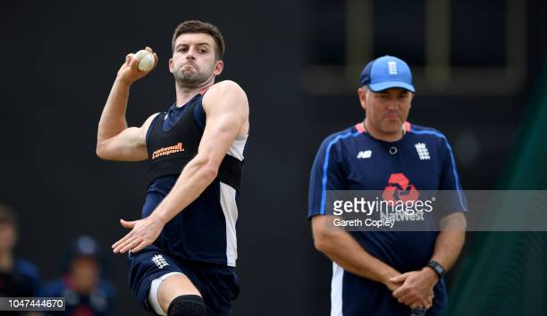 Mark Wood of England bowls watched by bowling coach Chris Silverwood during a nets session at Rangiri Dambulla International Stadium on October 8...