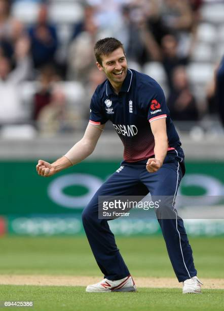 Mark Wood of England celebrates after dismissing David Warner during the ICC Champions Trophy match between England and Australia at Edgbaston on...