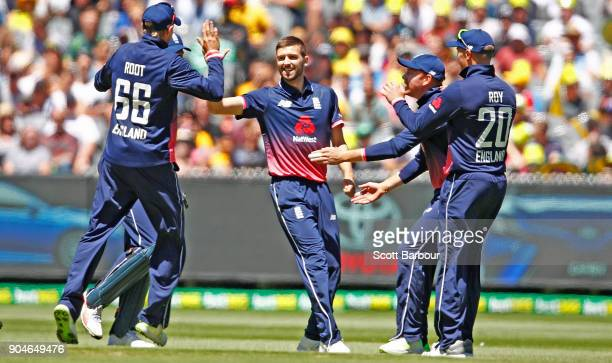 Mark Wood of England celebrates after dismissing David Warner of Australia during game one of the One Day International Series between Australia and...
