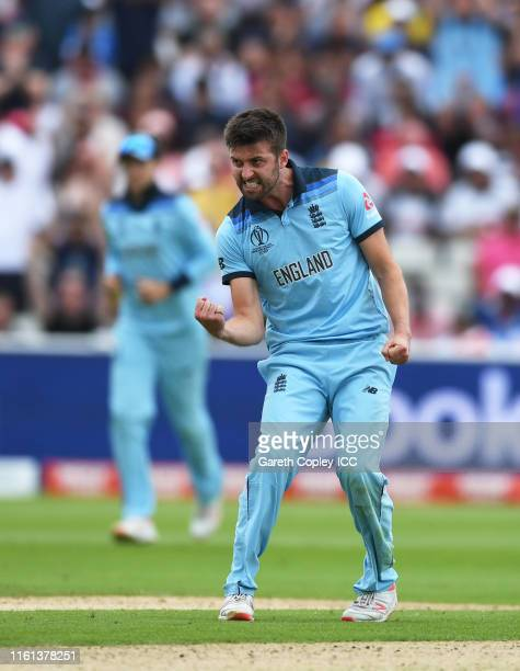 Mark Wood of England celebrates after dismissing Jason Behrendorff of Australia during the SemiFinal match of the ICC Cricket World Cup 2019 between...