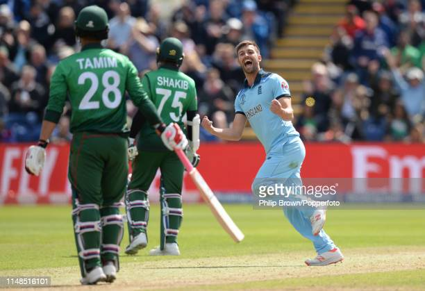 Mark Wood of England celebrates after dismissing Tamim Iqbal of Bangladesh during the ICC Cricket World Cup Group Match between England and...
