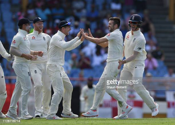 Mark Wood of England celebrates after taking the wicket of Darren Bravo of West Indies during Day Two of the Third Test match between the West Indies...