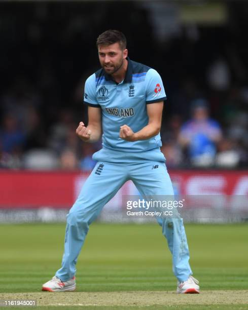 Mark Wood of England celebrates after taking the wicket of Ross Taylor of New Zealand during the Final of the ICC Cricket World Cup 2019 between New...