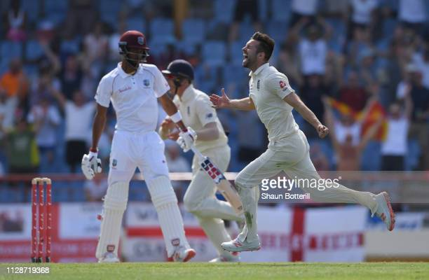 Mark Wood of England celebrates after taking the wicket of Roston Chase of West Indies during Day Two of the Third Test match between the West Indies...