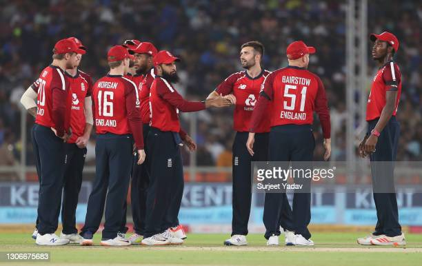 Mark Wood of England celebrates after taking the wicket of Shikhar Dhawan of India with team mate Adil Rashid during the 1st T20 International match...