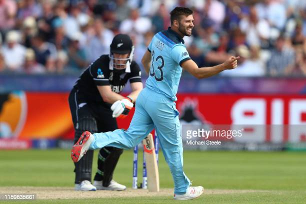 Mark Wood of England celebrates bowling Jimmy Neesham of New Zealand during the Group Stage match of the ICC Cricket World Cup 2019 between England...