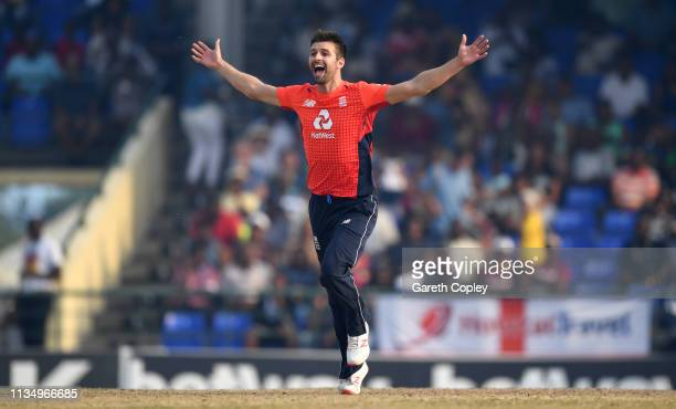 Mark Wood of England celebrates dismissing Carlos Brathwaite of the West Indies during the 3rd Twenty20 International match between England and West...