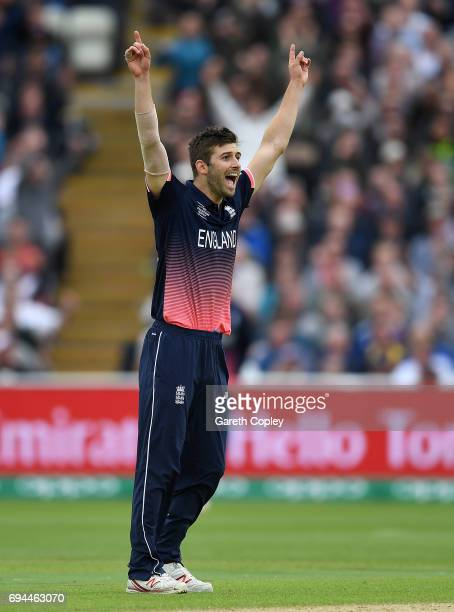 Mark Wood of England celebrates dismissing Glenn Maxwell of Australia during the ICC Champions Trophy match between England and Australia at...