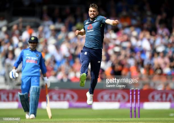 Mark Wood of England celebrates dismissing Hardik Pandya of India during the 3rd Royal London OneDay International match between England and India at...
