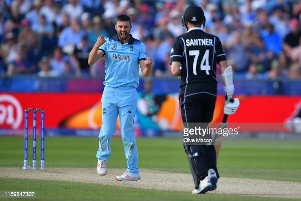 Mark Wood of England celebrates dismissing Mitchell Santner of New Zealand during the Group Stage match of the ICC Cricket World Cup 2019 between...