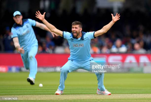 Mark Wood of England celebrates dismissing Tom Latham of New Zealand during the Final of the ICC Cricket World Cup 2019 between New Zealand and...
