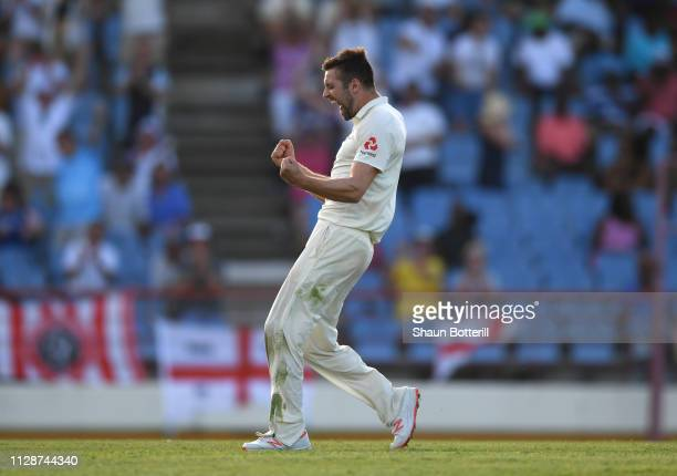 Mark Wood of England celebrates his 5th wicket during Day Two of the Third Test match between the West Indies and England at Darren Sammy Cricket...