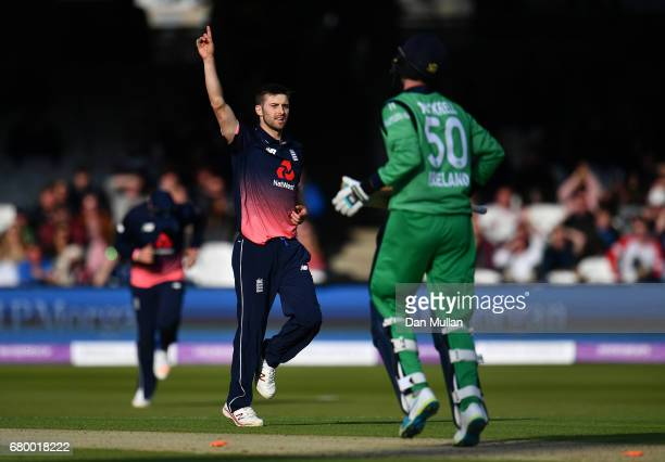 Mark Wood of England celebrates taking the wicket of George Dockrell of Ireland during the Royal London One Day International between England and...