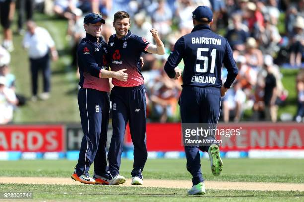 Mark Wood of England celebrates the dismissal of Colin Munro of New Zealand during game four of the One Day International series between New Zealand...